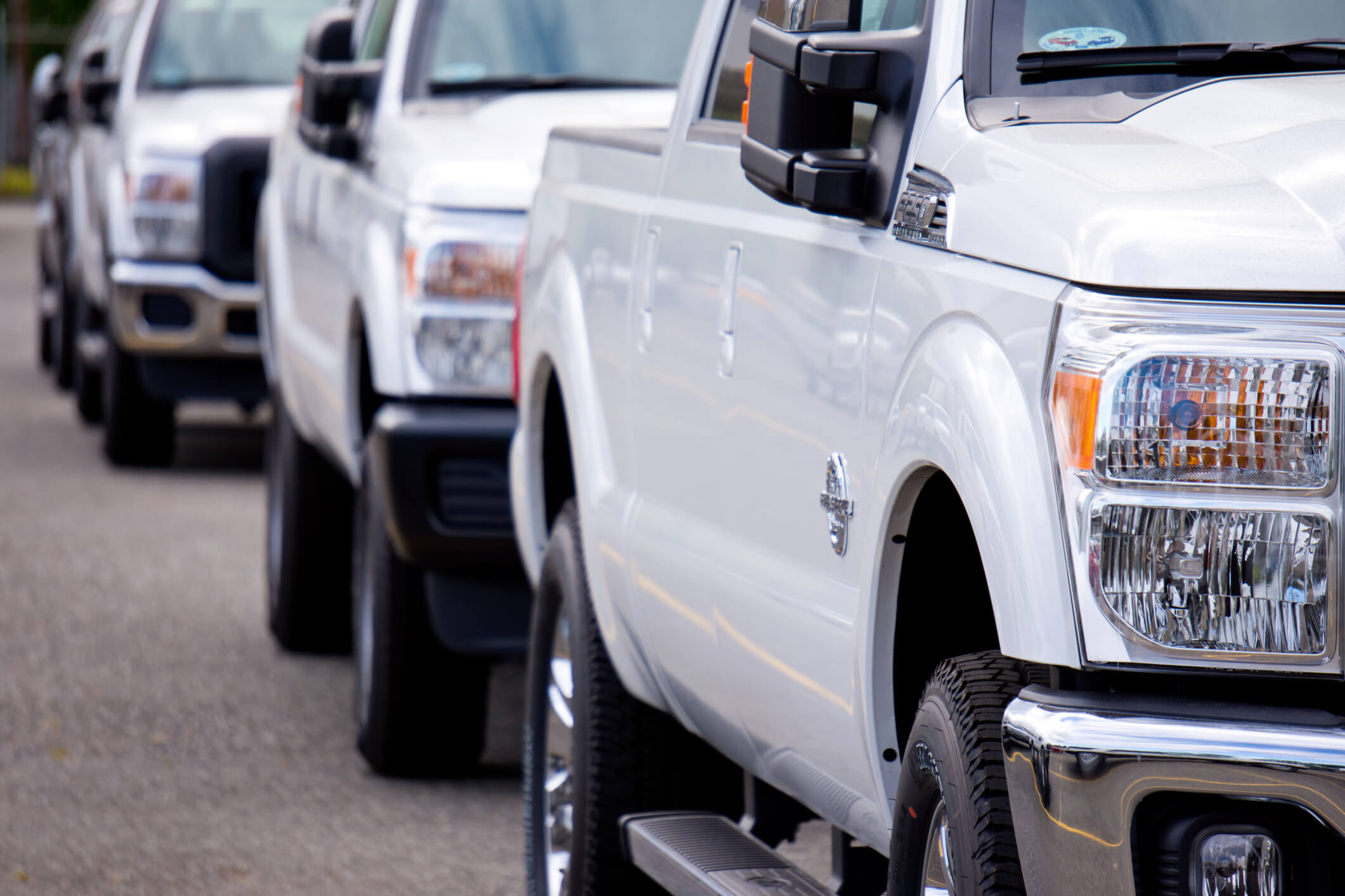 Ford Super Duty pick-up trucks lined up.